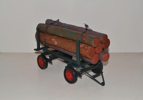Traktor Anhänger mit Holzladung Ansicht links